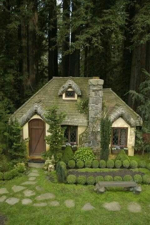 Looks like a fairy or hobbit house. Cute