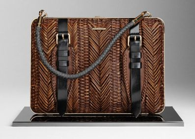 I have to say I was never a fan of Burberry purses with its preppy vibe and all until I saw this. Gotta love their SS12 collection!