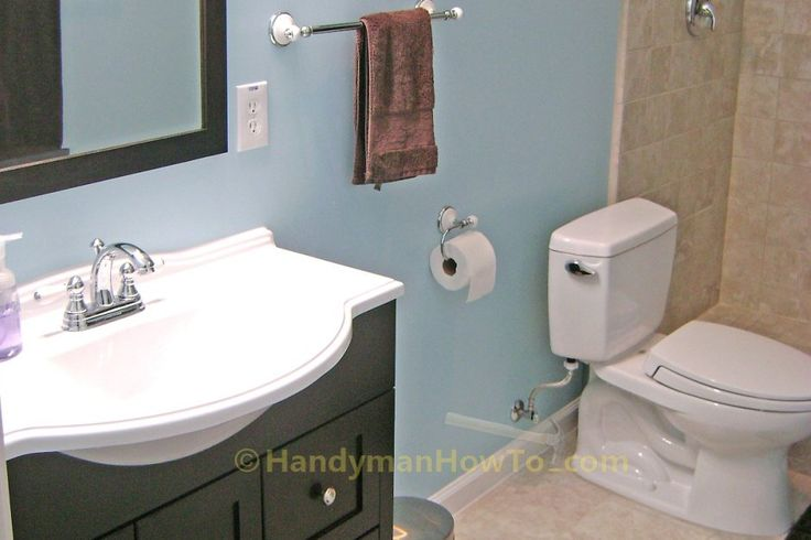 How to finish a basement bathroom complete project series with photos. Total cost, plumbing rough-in, sewage pump, tile and electrical installation.
