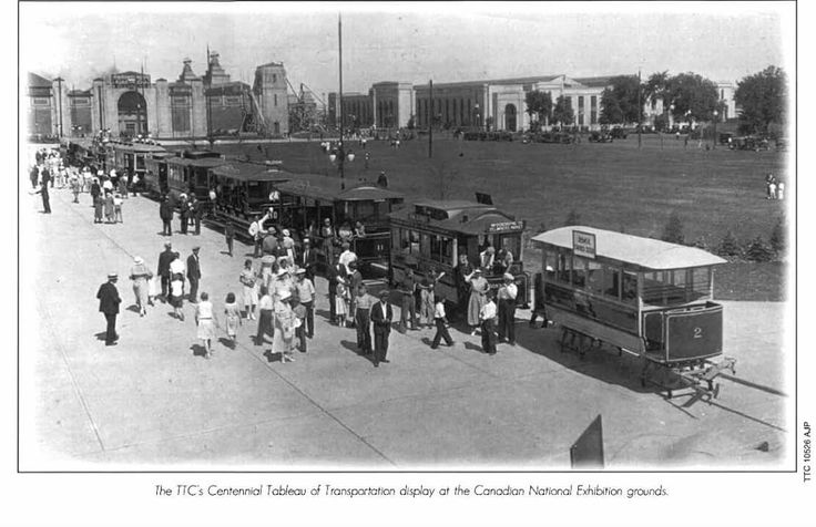 TTC Historical Exhibit at the CNE, 1934. To celebrate the 100th anniversary of the incoporation of the City of Toronto in 1934 the TTC Presented a special display of 18 historic vehicles in an area south of the CNE's East Entrance streetcar loop. In this view we see TSR Sleigh #2, TSR Horsecar #16, TRC Open Car #327 & open trailer #11, TRC Closed Car & closed trailer #64, a large Witt, TTC double-deck bus #1, White bus #17, a Charabanc, and a new Gray Coach General Motors bus #618. Numbers…
