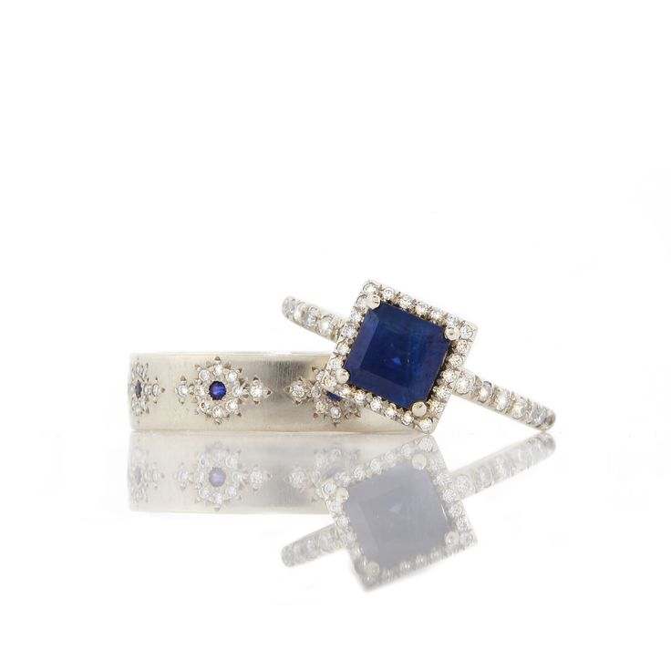 Gorgeous wedding ring set...Blue Sapphire and diamonds in white gold by Adel Chefridi #adelchefridi #askindredspirits #weddingrings #bluesapphirejewelry