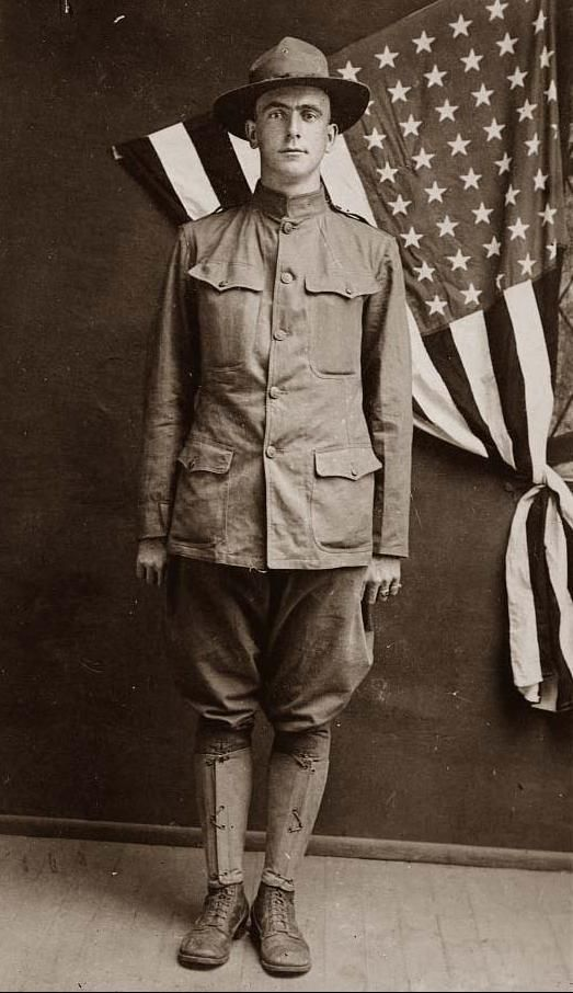 World War I SoldierYou are looking at an intriguing picture of Corp. Mart Gentry, an American World War I Soldier standing in front of a flag.    The picture presents Corp. Mart Gentry.