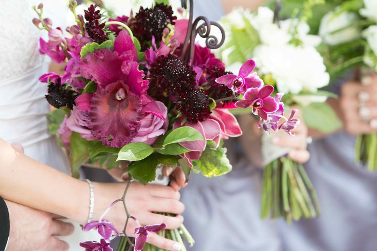 the bride is ready with her hand tied bouquet of lush purple hues.  a clutch of purple catelya orchid, purple dendrobium orchids, cool water roses, burgundy scabiosa, burgundy dahlias, purple cymbidium orchids, monkey tail fern, dark scented geranium leaf and galax leaf is hand tied with a piece of lace from her mother's wedding gown.