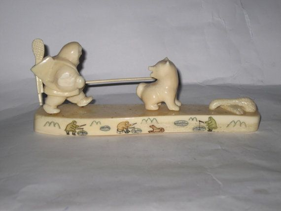 Inuit's art. Handcarved bone composition Eskimo in by expander12