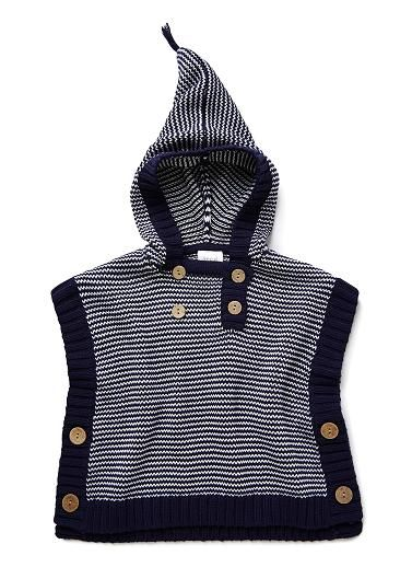 100% cotton hodded poncho with all over zig zag stitch and contrast rib trims. Featured front and side button openings