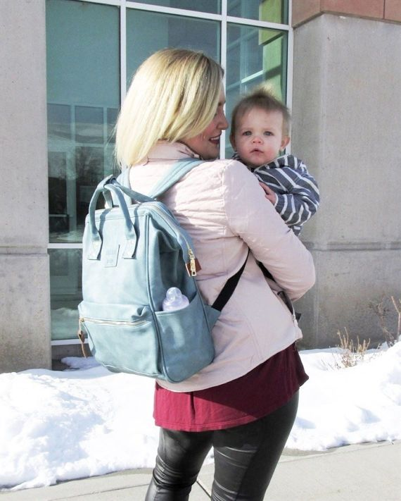 We are in LOVE with this backpack! Not just are they stylish, they also have all the features that you desire in a backpack!  It is big enough for all the ladies out there that are still going to school. It can fit in a laptop perfectly and still has room for other things. For all the MAMAs that are tired of DIAPER bags, this is the best transition to a toddler bag. It is big enough for all the essentials you will need for your little one! These backpacks also feature two side pockets that…