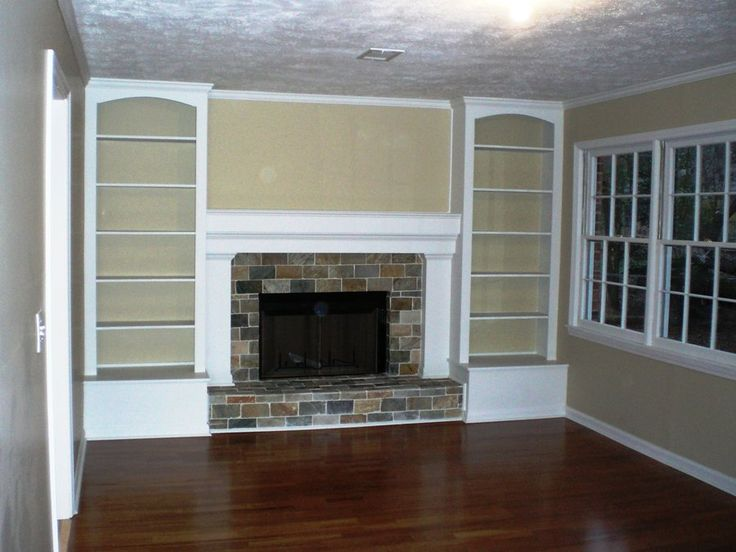 Originally a full brick wall with the tiny fireplace in the middle. Now with built-in bookshelves and a nice mantel. Good way to work around the raised hearth.