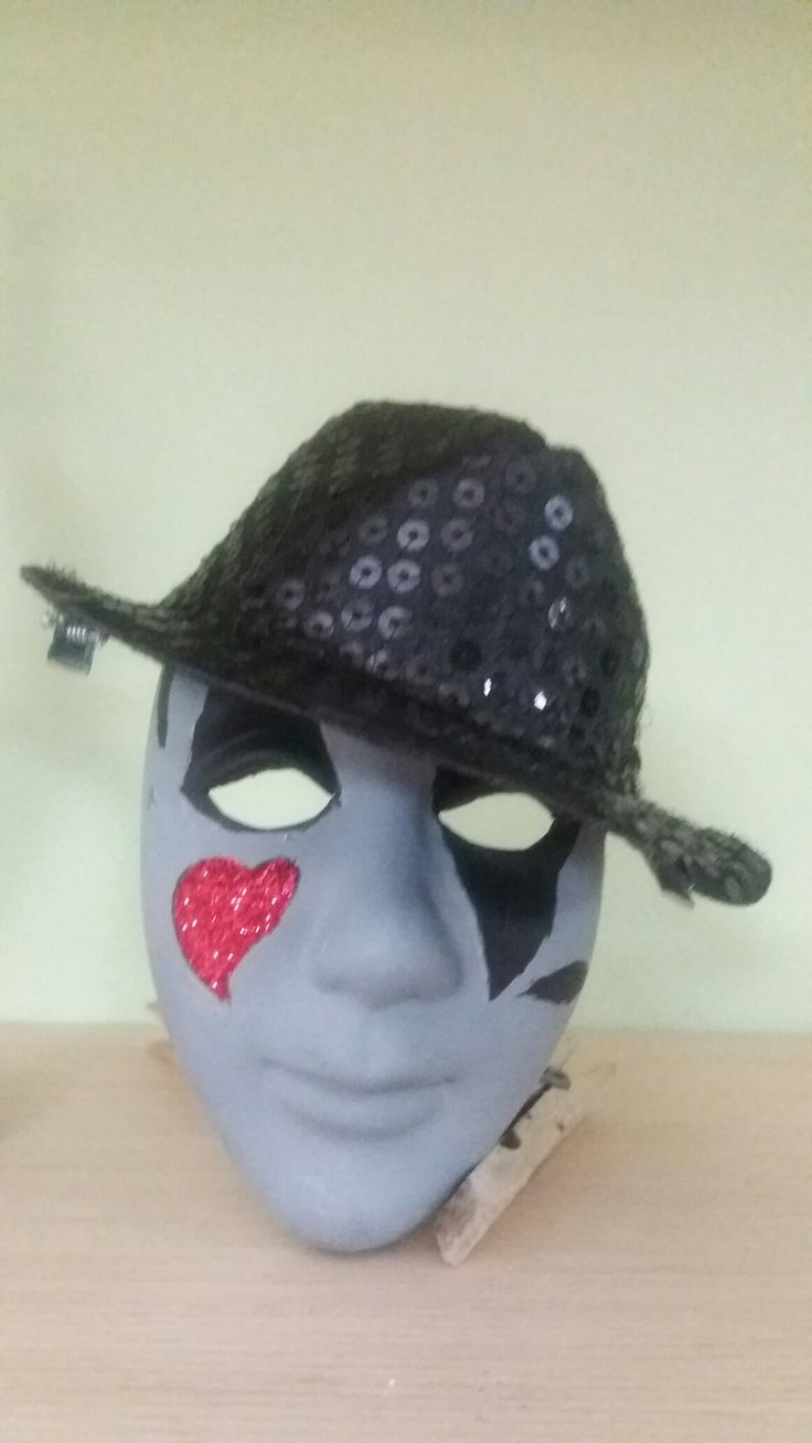 Clay Halloween mask with glitter and sparkly hat.