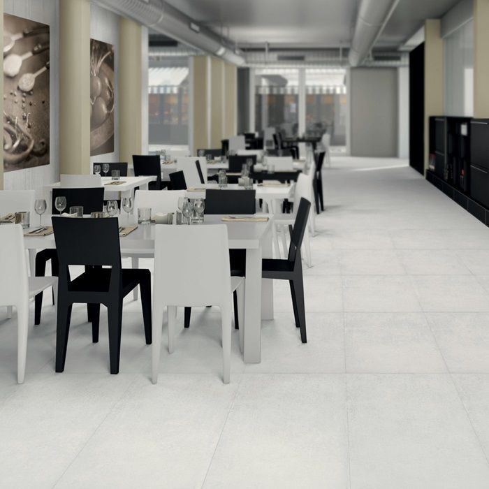 Cemento Bianco Rasato is a #porcelain tile that emulates a concrete appearance. It's great for residential and commercial use, like in this modern restaurant layout.#arizonatile