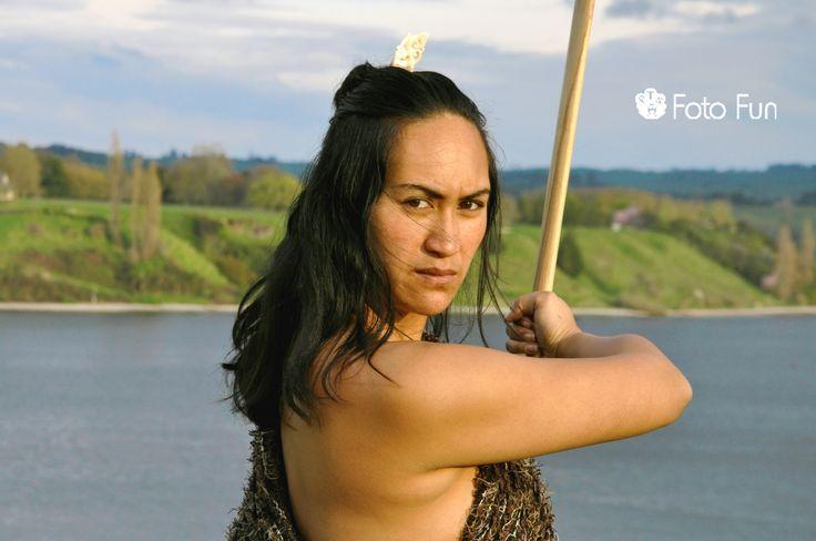 Amaing Maori woman with weapon in Karapiro lake
