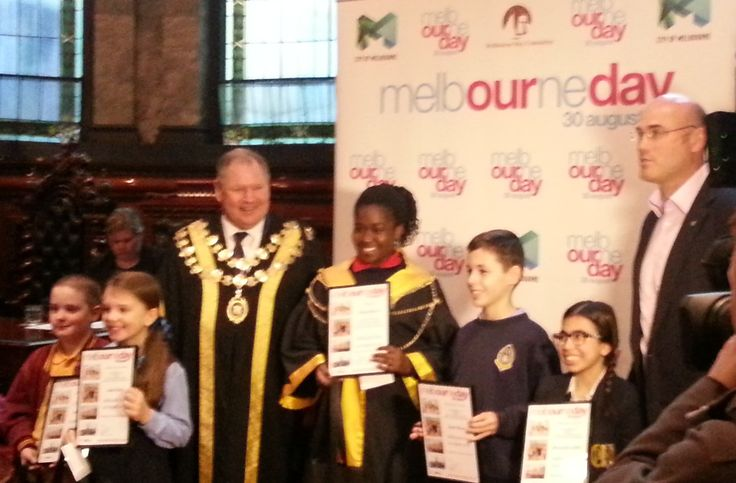 Junior Lord Mayor competition finalists with Lord Mayor Robert Doyle and Melbourne Day chairman Campbell Walker in the historic Melbourne Town Hall council chamber.