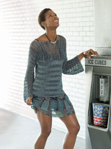 A breezy pullover for all shapes and sizes, the bodice and sleeves are knit in one piece in an easy lace stitch from cuff to cuff. The bottom is finished in stockinette.