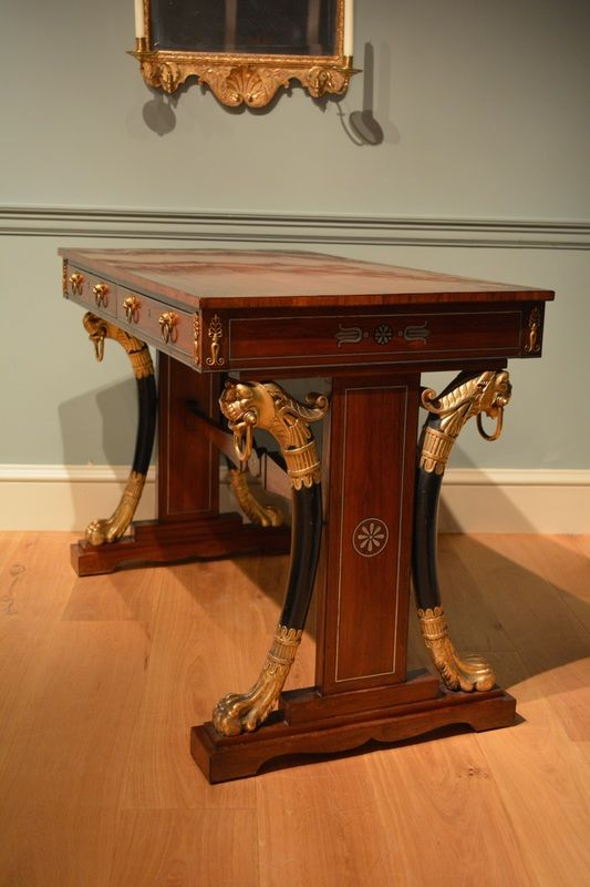 c.1810 Regency standard end writing table having gilded and ebonized lion monopodia to the base. The whole veneered in kingwood with brass and pewter inlay and ormolu mounts.  Circa 1810.