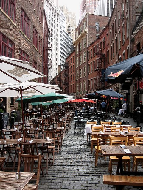 Downtown/Battery Park City : Pic is Stone street, first paved street in New York. Waterfront here, docks for ferries, borders Wall St area.