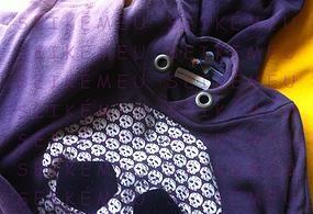 roupa camisola identificada com etiquetas termoaderentes personalizadas