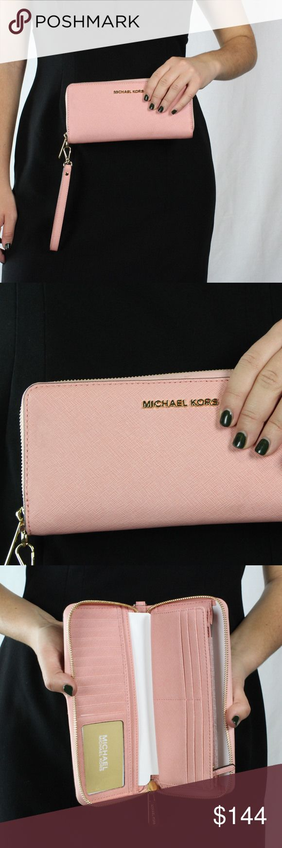 Women's Pink Michael Kors Wrist Wallet This pink Michael Kors wallet has a lot of space for your cards and it even has a zippable pouch where you can keep change and 5 other spots where you can keep cash and other thin items. So not only is it cute but it's also very spacious, which makes it a great item to have. SKU in warehouse is # 1219 Michael Kors Bags Clutches & Wristlets