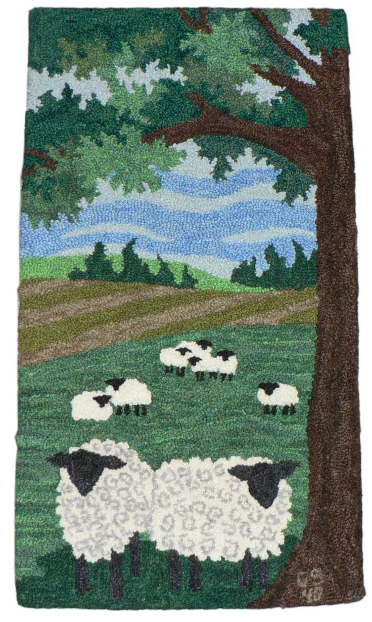 """Spring 2010. Design adapted from a quilt pattern and punched by Cherie Selles, Clare, Michigan. Made with The #14 """"Mini"""" Oxford Punch Needle and worsted weight yarn. The wool was hand dyed by Cherie. 15"""" X 18""""."""