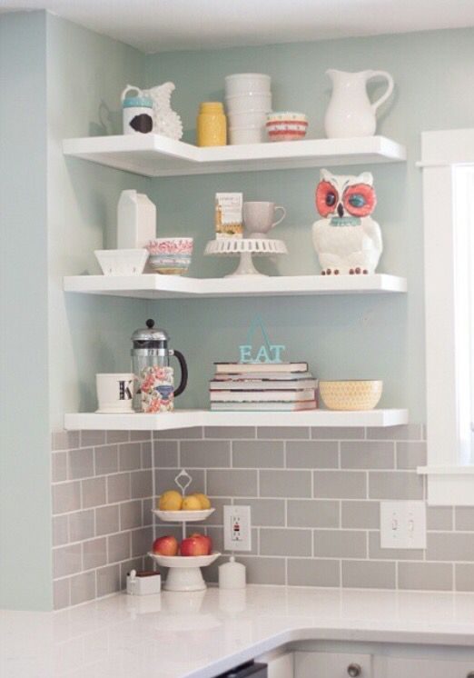 """An """"after"""" of our kitchen remodel. #subwaytile #whitekitchen #openshelving L shaped shelves"""