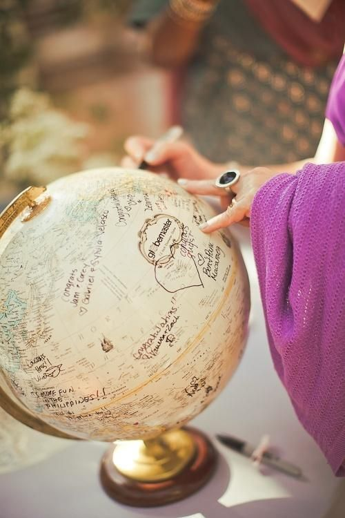 Unique Vintage Guestbook Idea, light white wash to tone down some of the colors on an old globe and diy graffiti or bon voyage messages