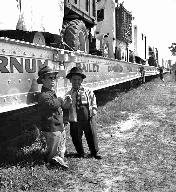 Florida Memory - Midgets standing next to the Ringling Circus train as it prepares to leave the winter quarters in Sarasota, Florida.