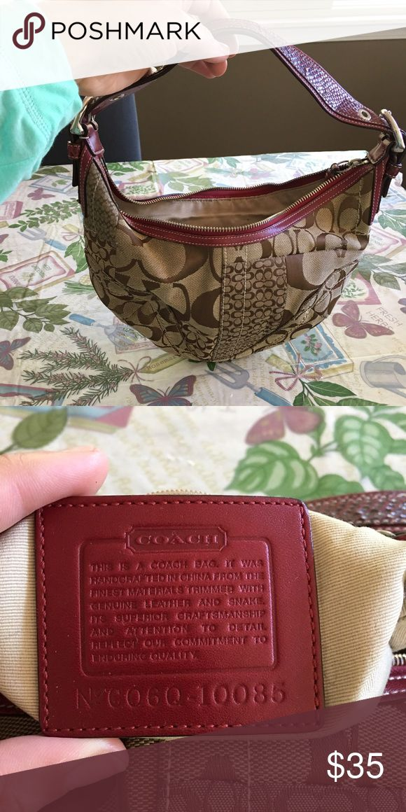 Authentic coach purse Authentic purse brown and burgundy with silver hardware handle looks like snake skin or alligator. Signs of wear on the outside the inside is khaki with marks as shown in pics. Dimensions are 11 1/2 in W x 6in H x 6in D x 12 in from handle. Does have some pen marks on the inside that I've tried to get out but no luck. Willing to post more pics if needed Coach Bags Shoulder Bags