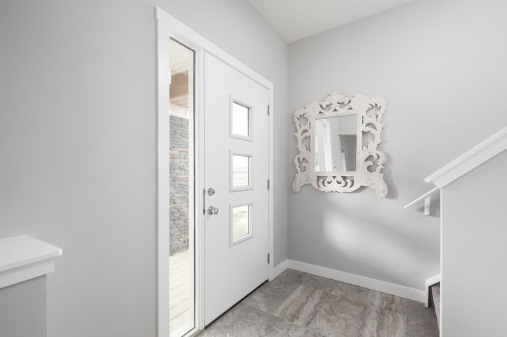 Foyer in Creations by Shane Homes Samara Showhome in Midtown in Airdrie #foyer
