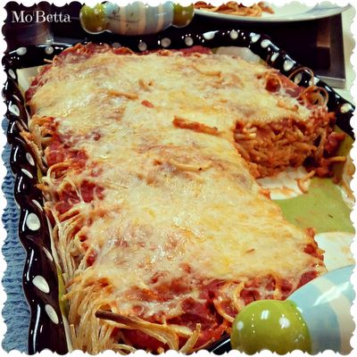 This. Is. Delicious. I used ground beef, Ragu, about 6 oz of cream cheese, and probably a cup and a half of an Italian blend of shredded cheese in a bag (parm, asiago, provolone, cheddar). It was the best spaghetti I've ever had.  Baked Cream Cheese Spaghetti Casserole