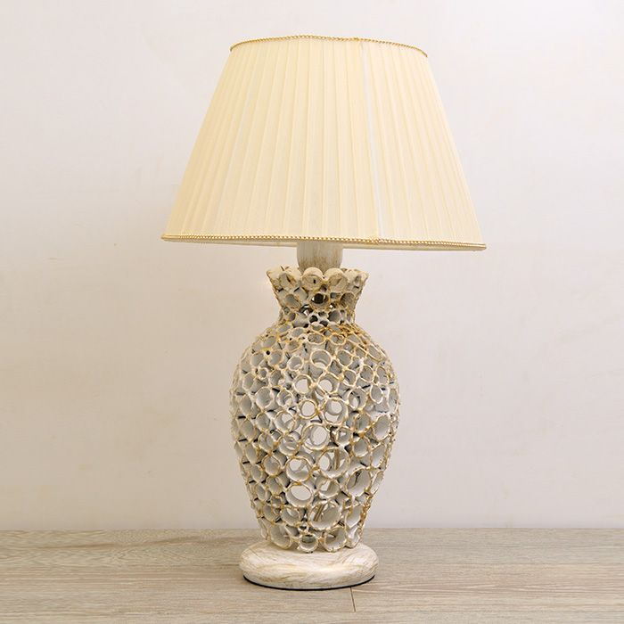This table lamp offers lovely elements in a well-executed package. The base is a finely wrought-iron crafted, vase-shaped base is made up of iron tubes and finished in iridescent ivory and gold. An artistic accent for a living room or bedroom. - See more at: http://www.montaltolamp.com/en/buccola#sthash.RDiB9d3U.dpuf