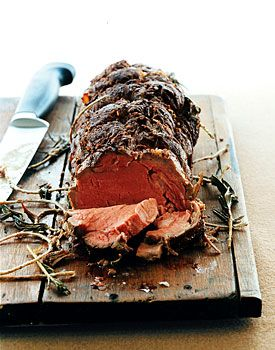 Rosemary Beef Fillet Recipe at Epicurious.com  1 (3 1/2-lb) trimmed and tied center-cut beef tenderloin roast at room temperature  4 teaspoons kosher salt  1 teaspoon black pepper  2 garlic cloves, finely chopped  6 (3- to 4-inch) fresh rosemary sprigs  3 tablespoons extra-virgin olive oil    Accompaniment: coarse-grain or Dijon mustard