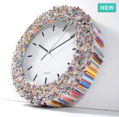 Love this wall clock. So colorful, hand made and each one individually designed. This designer has some great photo frames as well.
