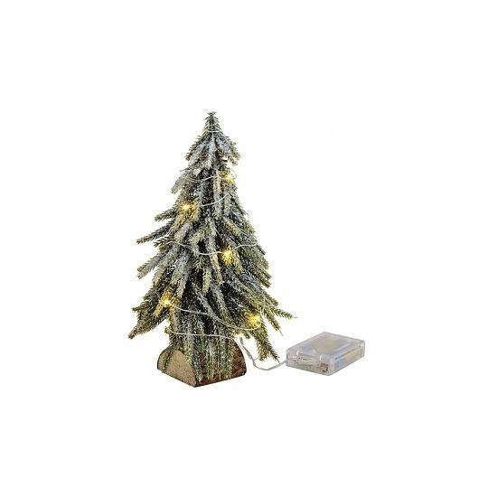 Deze mini kunst kerstboom op houten boomstammetje is bestrooid met sneeuw heeft een afmeting van 16 x 26 cm. De lichtjes werken op 3 AA-batterijen, niet inbegrepen.