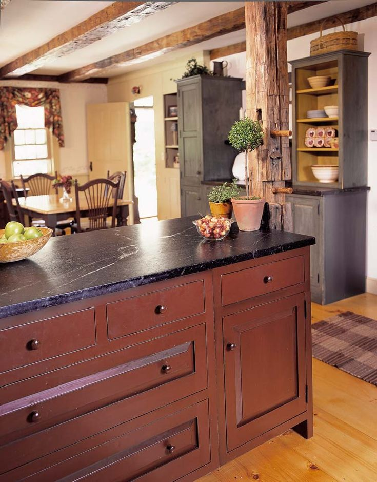 Love the color and door/drawer style.  Reminds me of my house with the beams.
