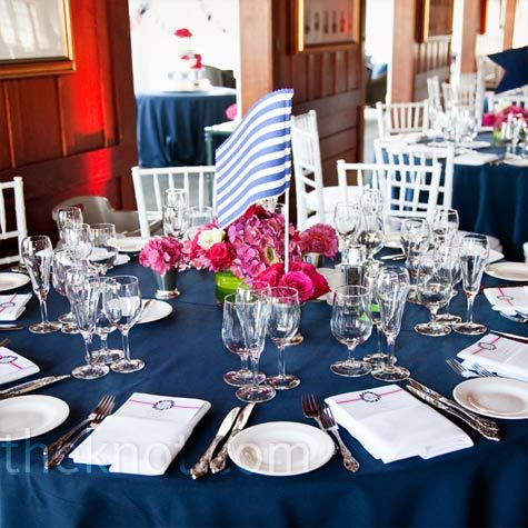 Navy Blue Linens Topped The Round Tables, And Preppy Yacht Flag Table  Markers Were Set Inside The Centerpieces.