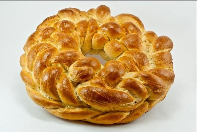 This recipe for Ukrainian Christmas bread or kolach is a slightly sweet yeast bread recipe that is braided and shaped into a loaf or round, stacked braids.