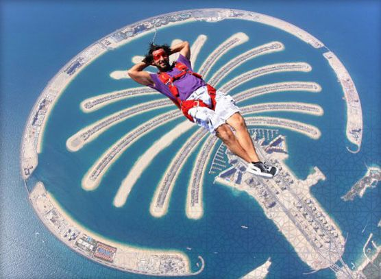 Ski Diving in Dubai-Other video will pop up. Just scoot bar to end of video. Then select the 3rd video out of the 12 in porfolio.