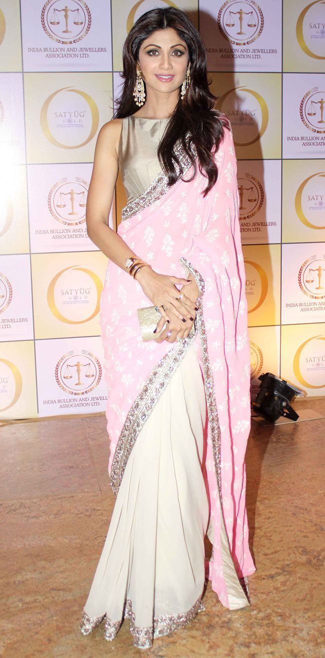 Shilpa Shetty in a pale pink saree or sari and blouse. Indian fashion.