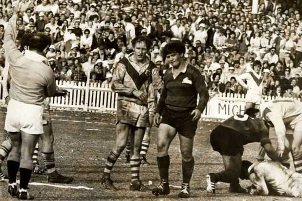 Tough going: George Piggins is cautioned by the referee during the 1971 NRL…