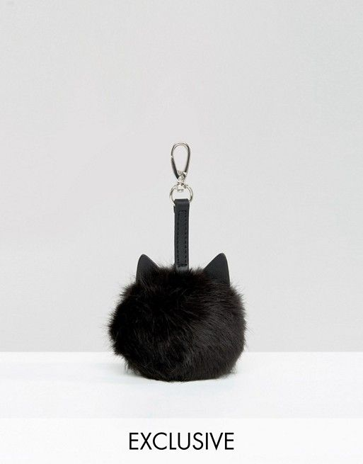 ONLINE ASOS EXCLUSIVE!!! Look at this adorable fuzzy cat key chain, it's super stylish for any purse! Check the link to shop this online only accessory!