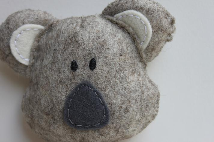 Lovely Koala handmade with a fantastic quality 100% pure merino wool felt and fill with natural wool.  This soft toy is handsew with cotton thread.  His sweet vest (is removable) is made with 100% soft wool.