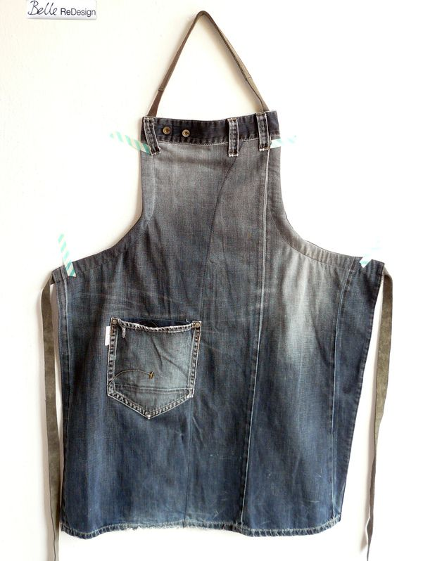 Apron made of old jeans. With leather straps and a reused pocket.