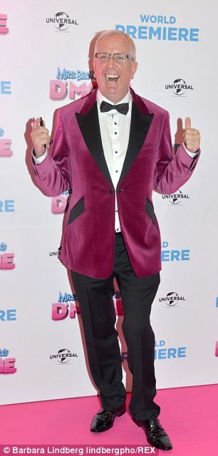 In high spirits: Rory Cowan poses at the film premiere...