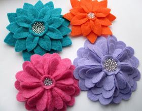 New in my Etsy shop  - a quartet of layered felt flower brooches:   All the flowers are made up of lots of individual hand-cut petals, sewn ...