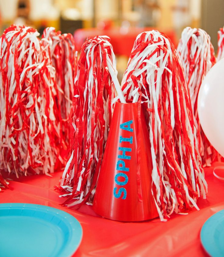 Megaphones and Pom Poms table decorations and favors at Cheerleading Party!  That Party Chick!  For party details visit www.thatpartychick.net