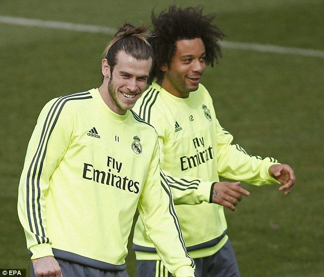 Bale is all smiles as he trains alongside Real Madrid team-mate Marcelo