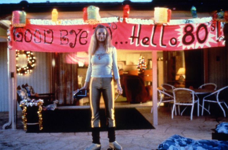 """Boogie Nights"" movie still, 1997.  Heather Graham as Rollergirl.  The New Year's Eve scene in this movie is an elaborate three minute tracking shot that goes inside and outside of the house twice and ends with a bang (pun intended)."
