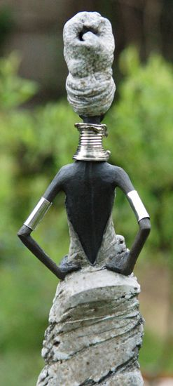 DAILY MUSE: Toni Foard,  describes himself as an English potter, hand builds each female figure using white clay.