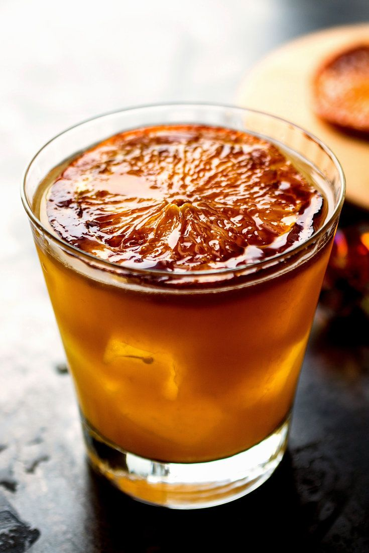 NYT Cooking: I mixed bourbon, ginger liqueur and sherry with a little fresh orange juice. And in a moment of inspiration, I gussied up the orange garnish by caramelizing the slices before placing them afloat in the drinks. I loved the way it looked and how it tasted. The sweet seared orange perfumes every sip.