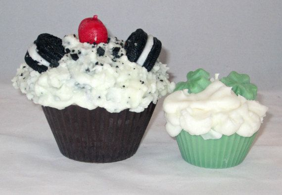 This Oreo style cookies and cream cupcake candle is approximately 11 ounces. The cake portion of the candle deep chocolate (almost black) color. Topped with one Oreo, cookie crumbs and a cherry. The candle is scented with cookies and cream fragrance oil.