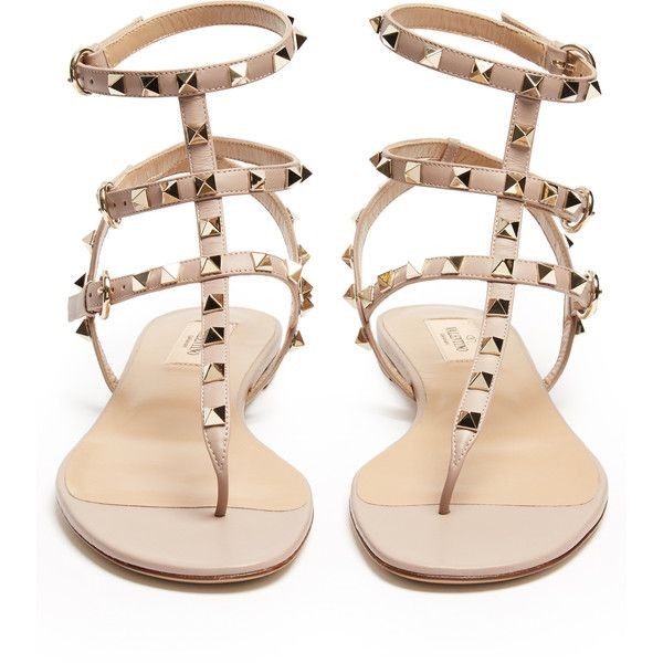 Valentino Rockstud T-bar leather flat sandals ($975) ❤ liked on Polyvore featuring shoes, sandals, momma shoes, flats, valentino, flat pumps, strap sandals, t-strap flats, t-strap shoes and t strap sandals