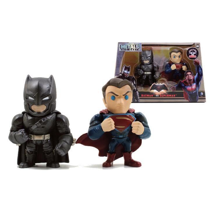 Coppia di statuette decorative di Batman e Superman.